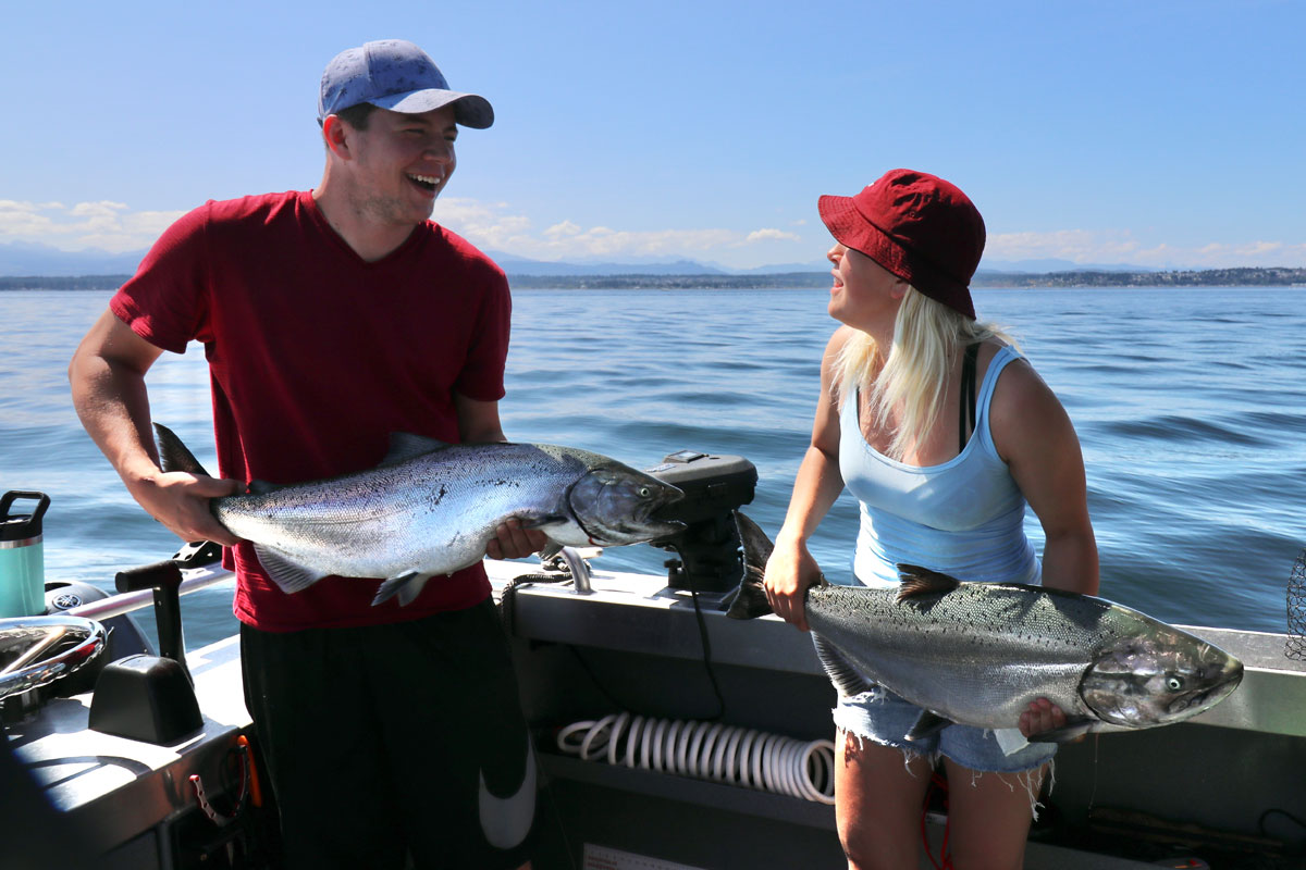 Man and Woman with Chinook Salmon